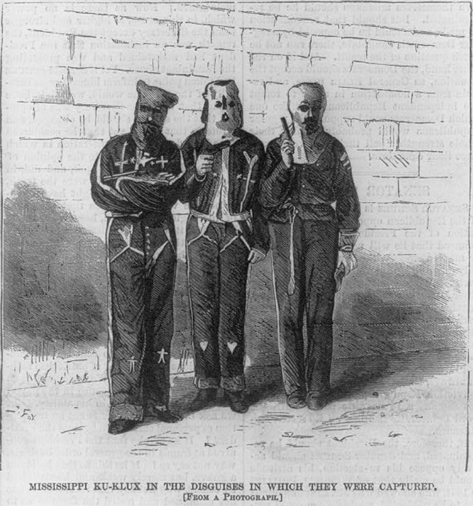 Picture of Klu Klux Klan Members from 1872 illustrating history of  racism in the U.S.